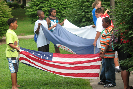 Kids learning to care for flags at the 4-H Summer Camp