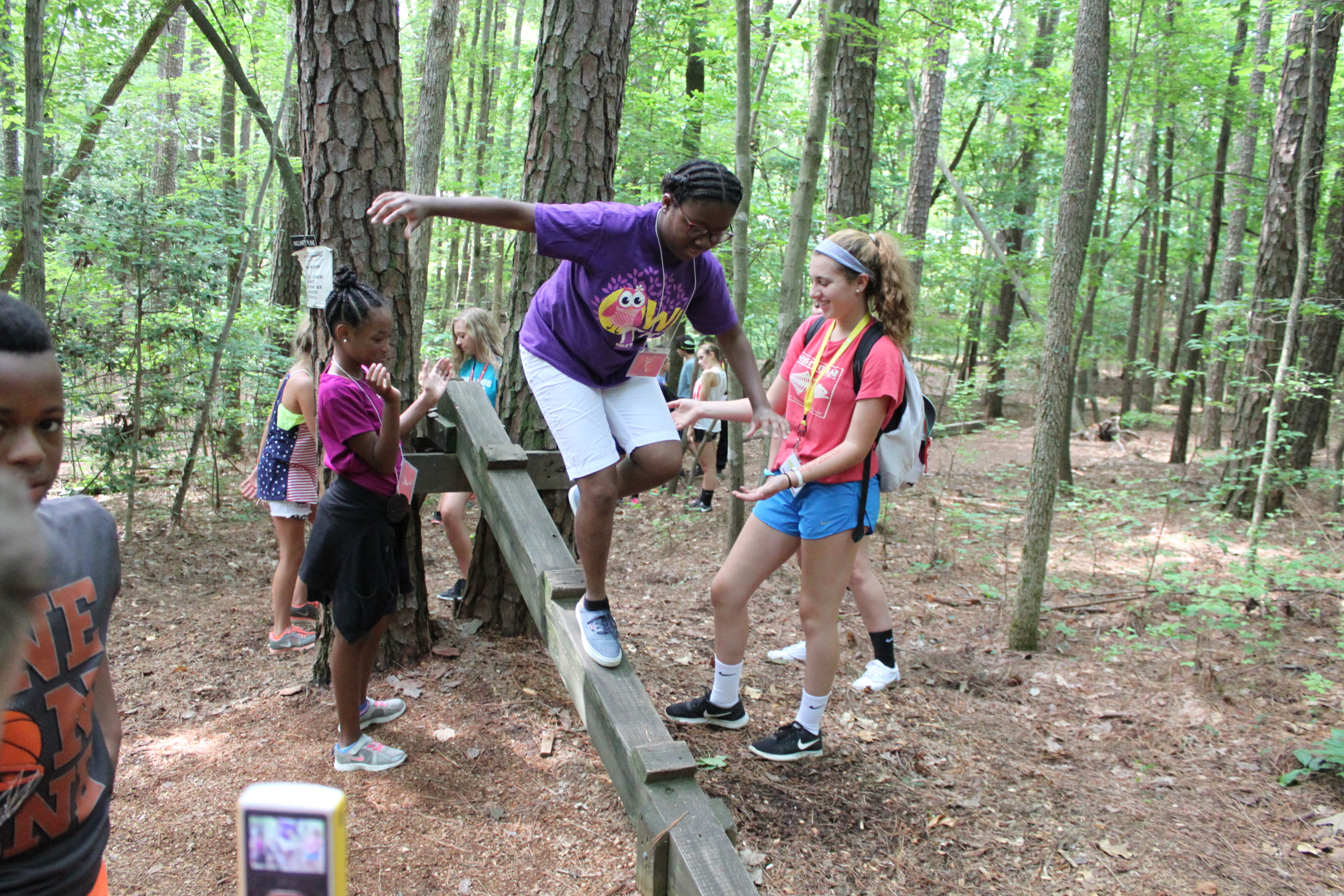 Kids participating in the ropes course